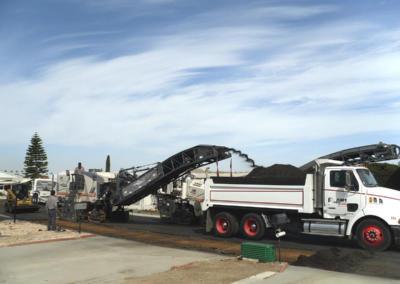 Grinder Loading Dump Truck