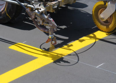 Striping Machine Applying Paint