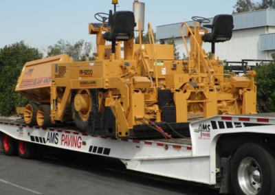 Paving Machine on Move Truck